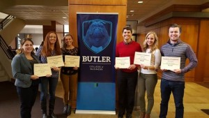 Photo of six of the students who participated in the Fall 2015 Business Research Workshop holding their certificates of completion