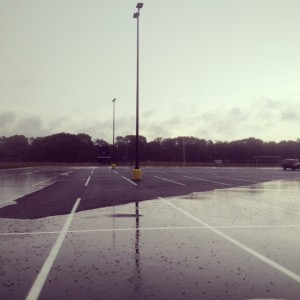 New parking lot at Butler University with pervious pavement.  Rain collects on the impervious sections.