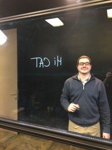 Larry writes on the glass